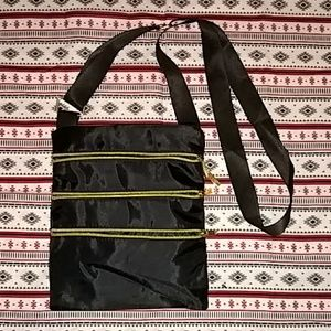 Black purse with gold zipper
